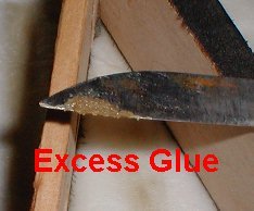 Excess soft glue is easily scraped off edge