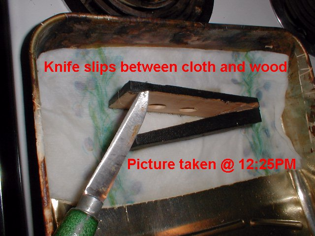 Knife slips easily between cloth and wood