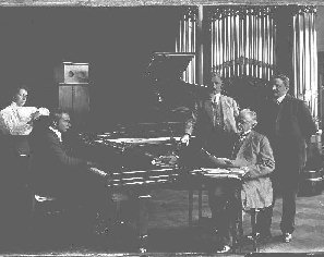 Hoffmann at the Welte-Mignon. Notice the long rectangular 'box' attached to the underside of the keybed.